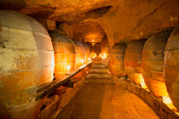 Fototapeta Antique winery in Spain with clay amphora pots obraz