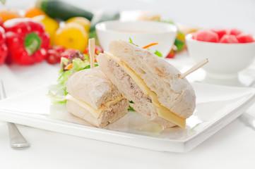 tuna and cheese sandwich with salad