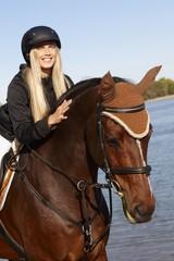 Closeup photo of rider and horse