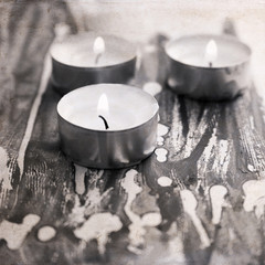 artwork  in grunge style,  three  burning candles,  painting bac