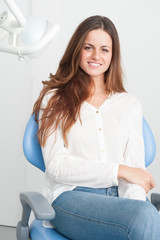 Happy patient at dentist surgery
