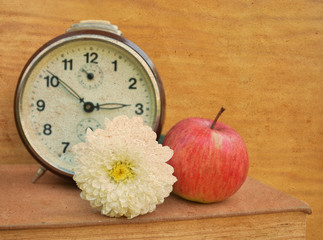 Vintage book with old clock and apple