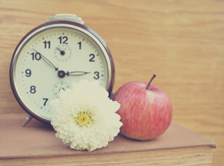 Vintage old clock and apple