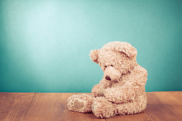 Teddy Bear toy alone in front mint green background