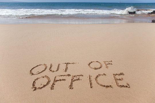 Out of office. Concept image in the sand on Hawaii beach.