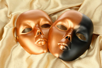 Mask on gold fabric background