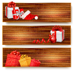 Three christmas banners with gift boxes and santa hat. Vector il