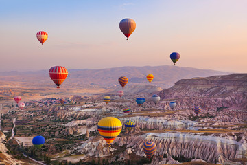 Hot air balloon flying over Cappadocia Turkey - fototapety na wymiar