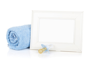 Photo frame with bath towel and boy dummy