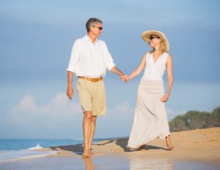 Happy senior couple on the beach. Retirement Luxury Tropical Res