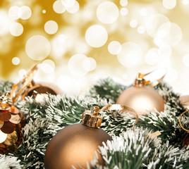 An arrangement of golden Christmas baubles against a festive bok