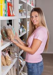 Woman Choosing Groceries In Supermarket