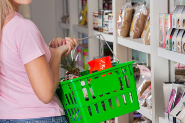 Midsection Of Woman Carrying Shopping Basket