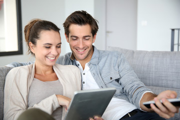 Couple looking for tv program on internet