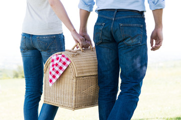 Closeup Of Couple Holding Picnic Basket