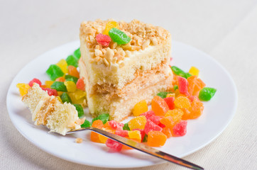 Delicious biscuit cake sprinkled with chopped nuts
