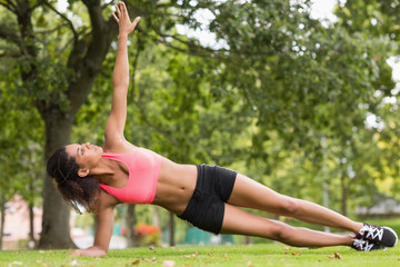 Full length of a toned woman doing stretching exercise in park