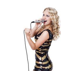 Smiling beautiful blonde woman with microphone