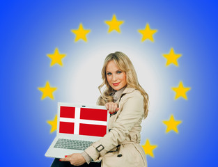 woman holding laptop with denmark flag on the screen