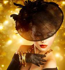 Wall Mural - Glamour Woman Portrait over Holiday Golden Background