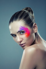 girl with coloured powder on face