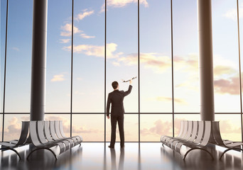 Wall Mural - businessman holding plane