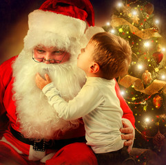 Santa Claus and Little Boy. Christmas Scene