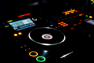 Turntable and LP vinyl record on a DJ music deck