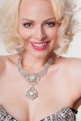 Pretty blond female smiling