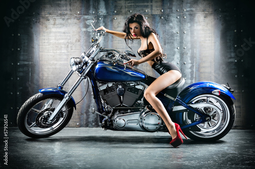 Fototapete Young sexy woman sitting on motorcycle.