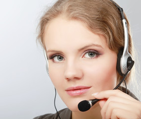 portrait of a call center employee wearing headset