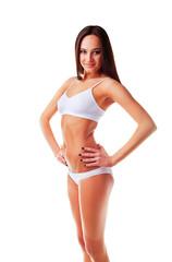 Sexy sporty slim woman on white background