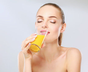 young woman with orange juice, isolated on white background