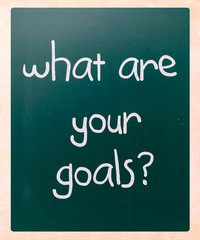 """""""What are your goals?"""" handwritten with white chalk on a blackbo"""