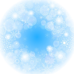 Blue snowflakes light winter background