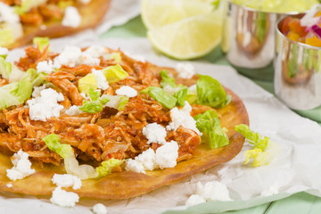 Tostadas - Mexican crispy tortilla with chicken tinga and cotija