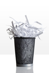 Trashcan full of shredded paper