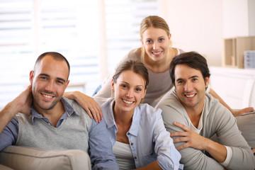 Portrait of friends sitting in sofa