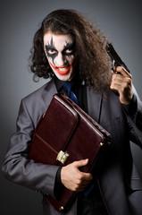 Joker with gun and briefcase