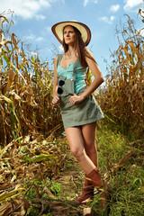 Attractive woman farmer in the cornfield