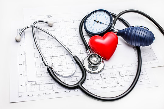 Medical tools lying on ECG