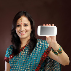 Smiling young traditional woman showing picture of herself
