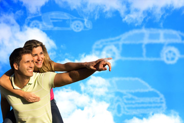 Couple pointing to clouds shaped like cars