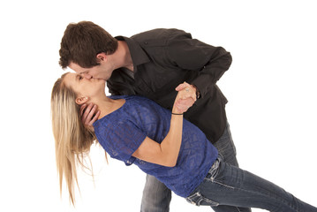 Young couple kissing leaning backwards