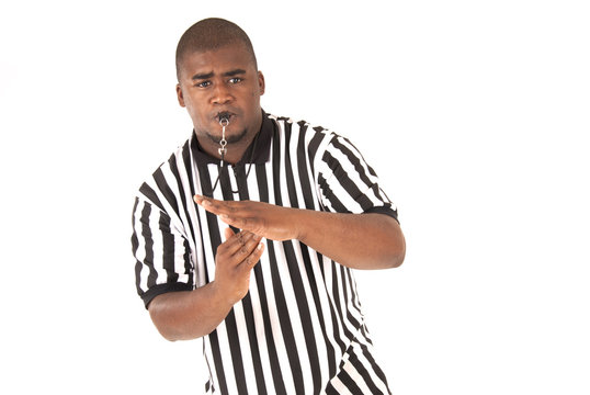 Black referee making a call of technical foul or time out