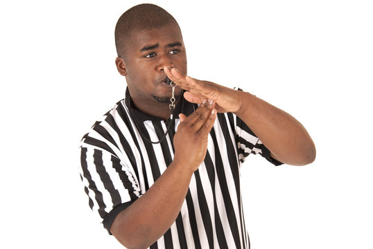 Black referee calling time out or a technical foul