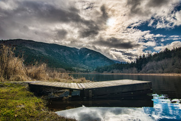 Fotomurales - Dock on Lake with Dramatic Clouds