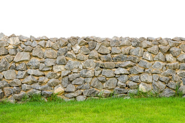 fence real stone wall surface with cement on green grass field