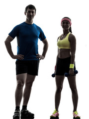 Wall Mural - woman exercising fitness workout with man coach posing