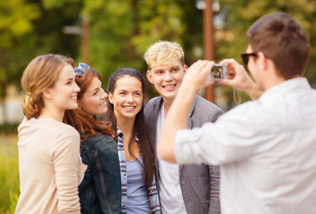 teenagers taking photo outside
